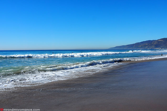 Mr-and-Mrs-Romance-Highway-1-Roadtrip-Malibu-Beach-waves.jpg