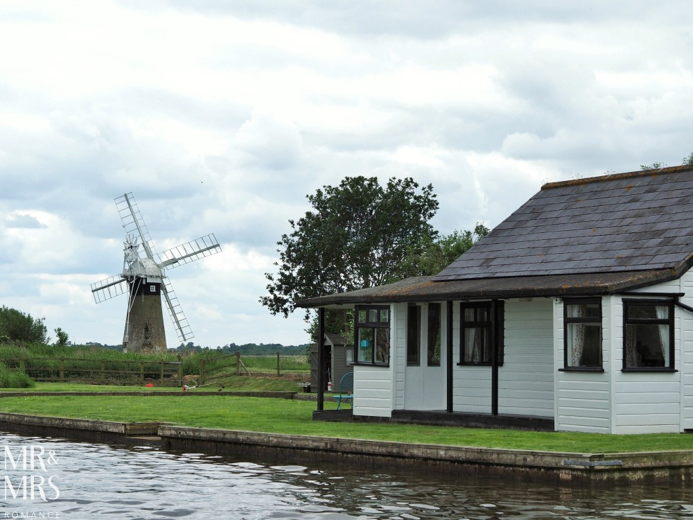 Boating holidays England - Norfolk Broads boat hire. Windmill and house