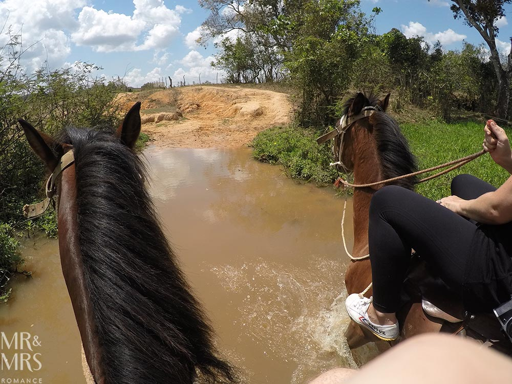 Horse riding in Cuba - Vinales - riding through river