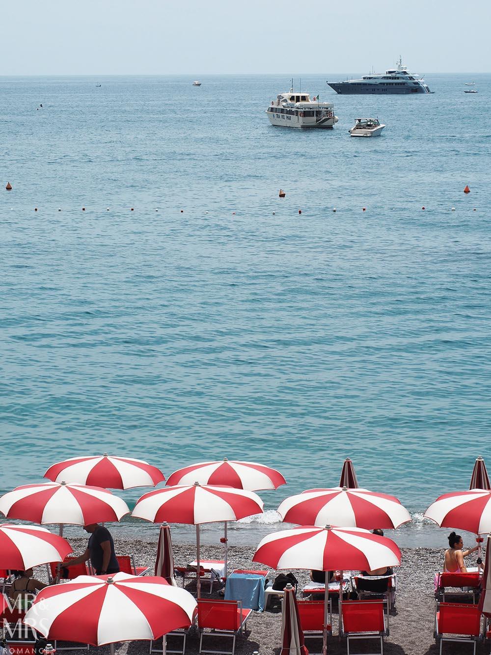 Red umbrellas and boats Amalfi Coast