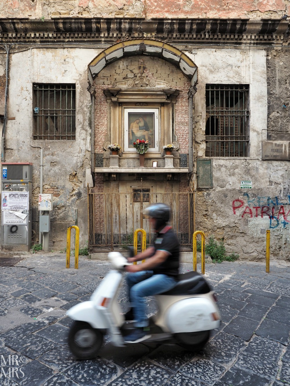 Hotel Piazza Bellini review - Naples street scene with moped