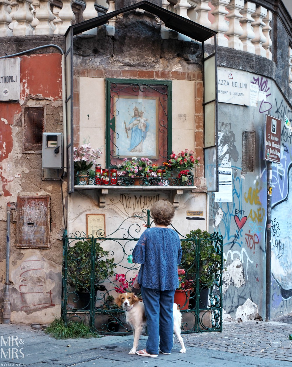 Hotel Piazza Bellini review - old lady with dog at madonna