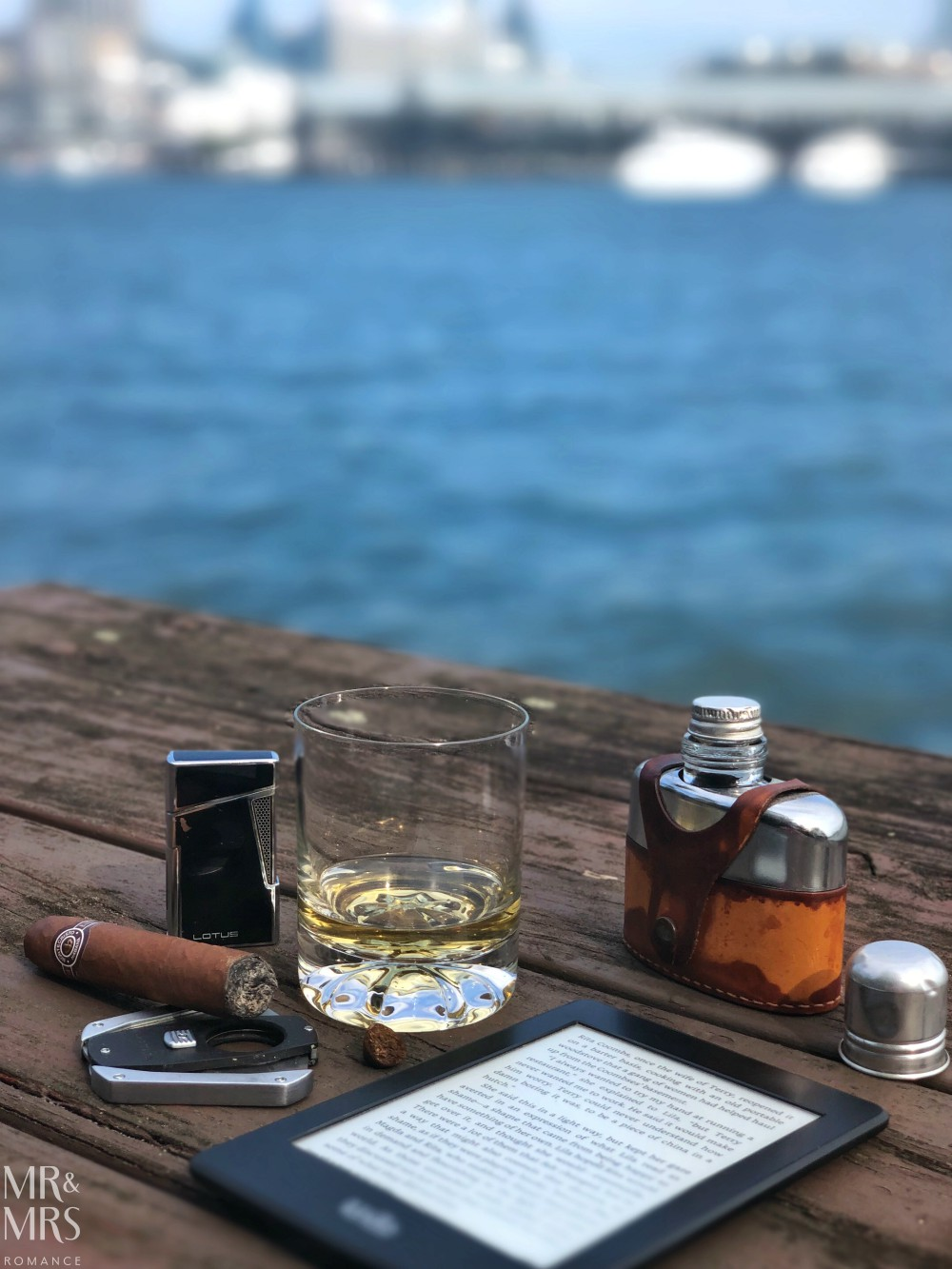 Cigar and whisky by the water