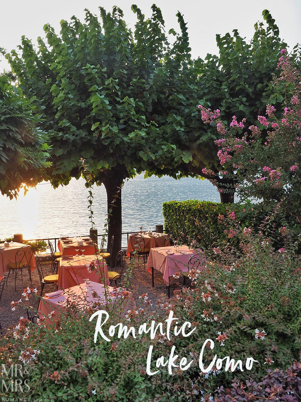 Ultimate Guide to Lake Como, Italy - Waterfront tables overlooking Lake Como. Trees, flowers and perfect light