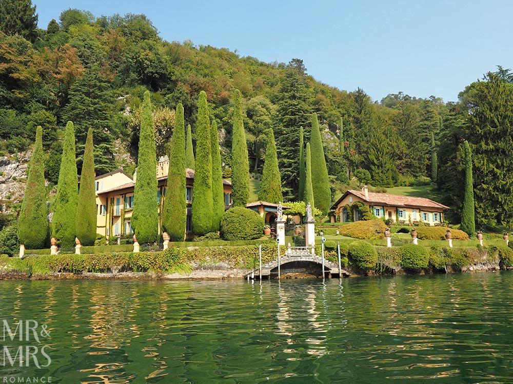Green garden and stone bridge of villa on Lake Como