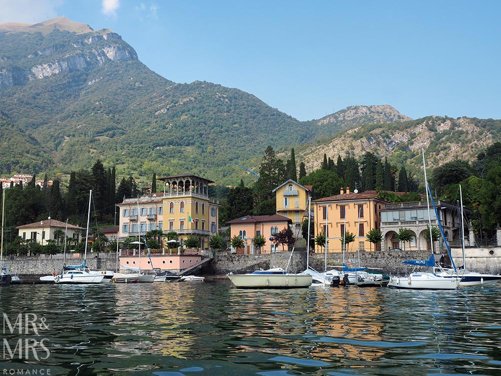 Ultimate Guide to Lake Como, Italy - Varenna and its stone shoreside wall from the water