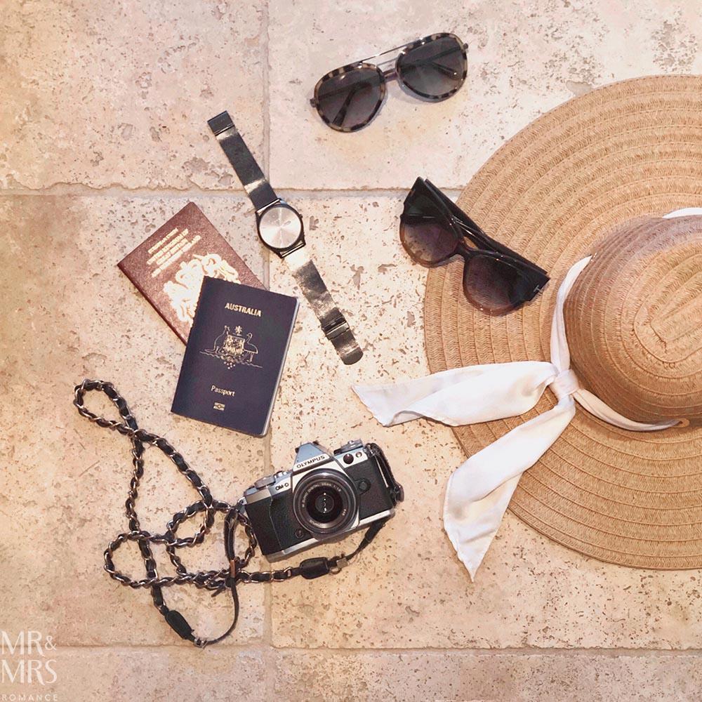 Summer flatlay - Tom Ford Sunglasses - Skagen Watch - Olympus Camera - HM hat