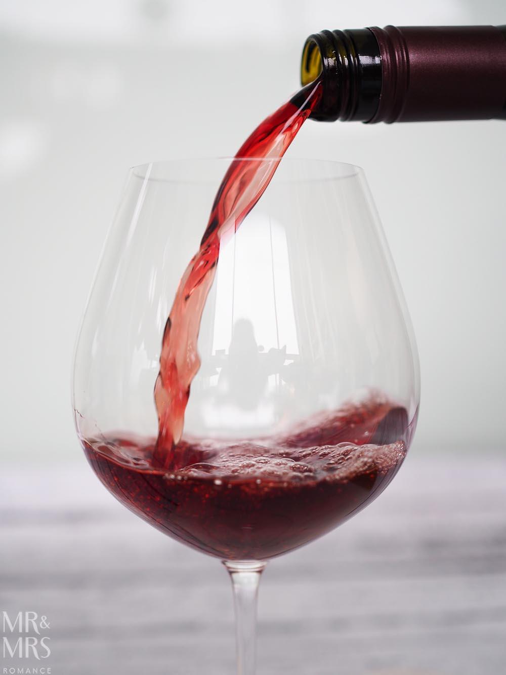 Kim Crawford Pinot Noir pouring